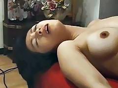 Asian babe gets anus and pussy fucked with vibrators
