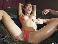 Asain hottie Nao Yoshikawa gets her pussy rubbed with toys
